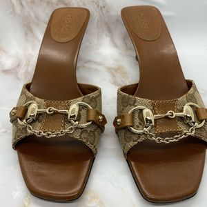 Authentic Gucci slide, with heel and chain detail
